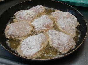 Pan full of frying chicken