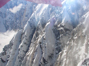 Rocky, knife-edged slopes below the wing of the plane