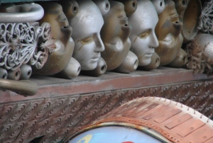 """""""Faces"""" line the eaves above the cups"""