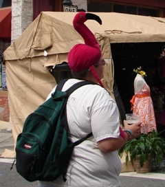 Woman wearing flamingo hat