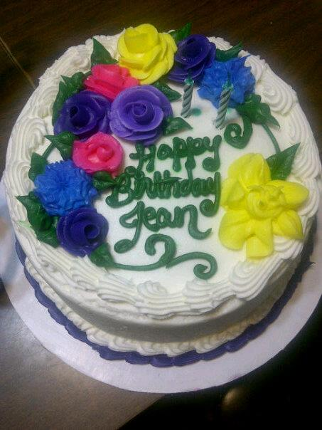 Birthday cake with lots of frosting flowers on top!
